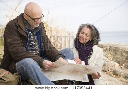 Mature couple looking at a map