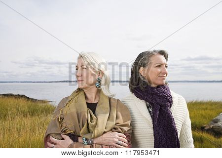 Two women near a lake