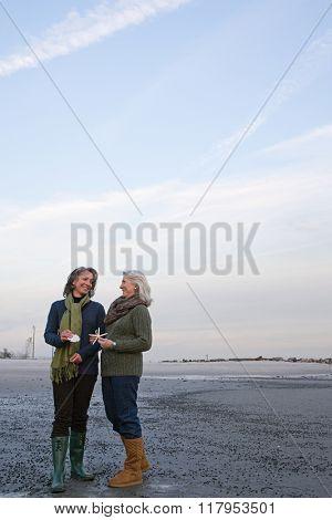 Mature women standing on a beach