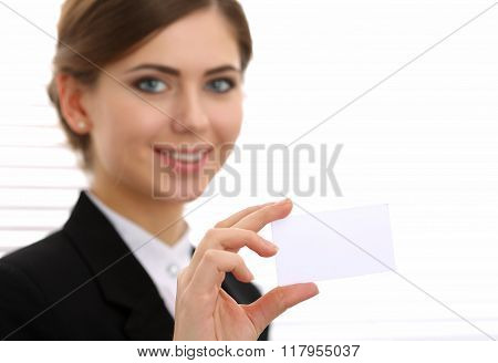 Businesswoman In Suit Hand Holding Blank Calling Card