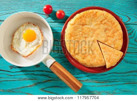 Egg over easy on white pan and potatoes omelette tapas from Spain