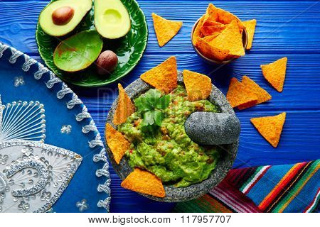 Guacamole with nachos avocado in Mexican molcajete and Sombrero hat