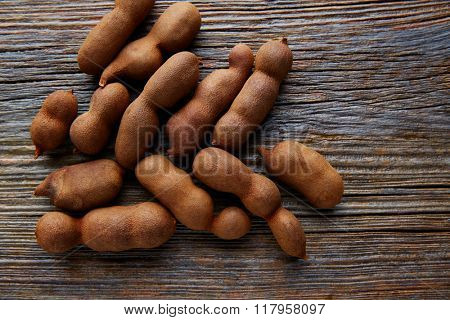 Tamarindo tamarind fruits ripe on brown wood background uses for candy