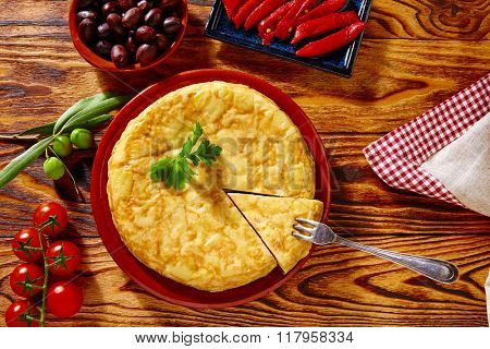Tapas tortilla de patata potatoes omelette in wooden table from Spain
