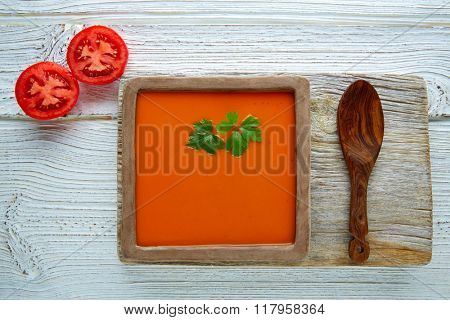 Tomato sauce on square clay dish and white wood