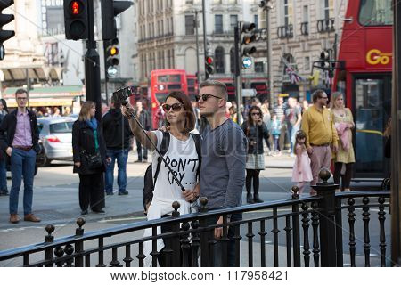 LONDON, Tourists making a selfie in Regent street
