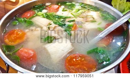 Serving Of Spicy Fish Soup Thai Style In A Hot Pot