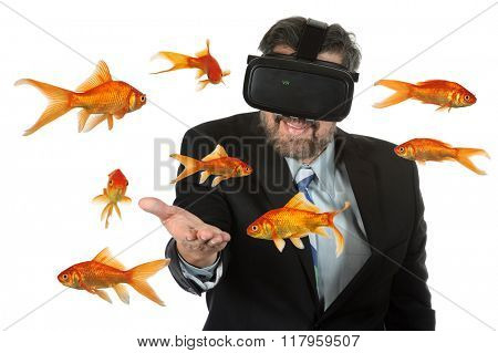 Businessman using virtual reality glasses with goldfish swimming