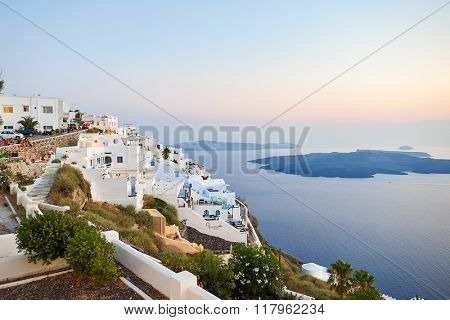 SANTORINI, GREECE - AUGUST 07, 2015: Santorini island at evening. It is the largest island of a small, circular archipelago which bears the same name and is the remnant of a volcanic caldera