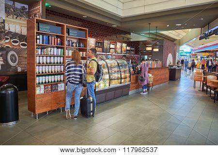 DUBAI, UAE - SEPTEMBER 08, 2015: interior of Starbucks cafe in Dubai Airport. Starbucks Corporation is an American coffee company and coffeehouse chain.