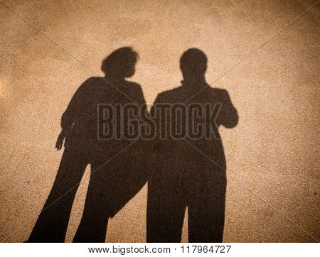 Shadow Of Couple On Road