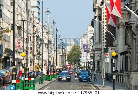Pall Mall street view with cars and people walking by