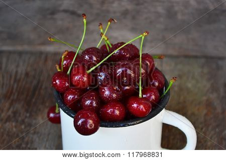 Ripe, fresh cherries in a mug
