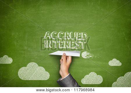 Accrued interest concept on blackboard with paper plane