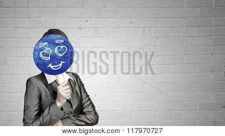 Woman applying card to face