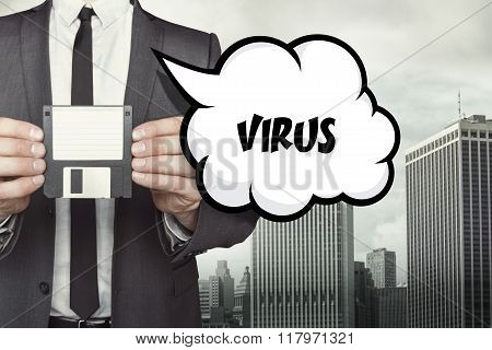 Virus text on speech bubble with businessman holding diskette