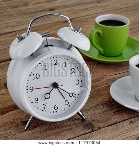 Two Cups Of Espresso With An Alarm Clock