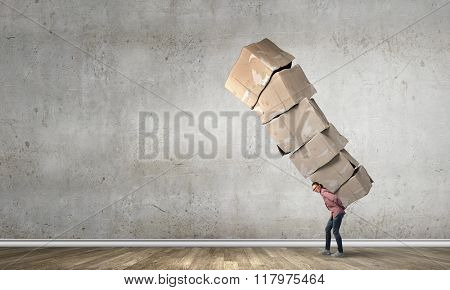 Girl with pile of boxes