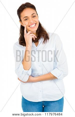 Thoughtful woman with finger on chin against white background