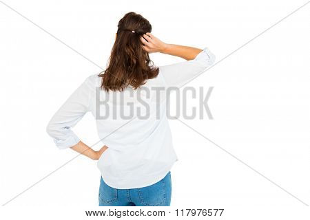 Rear view of woman scratching her head on white background
