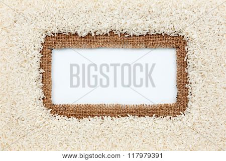 Frame Made Of Burlap And Rice Grains Lies On White Background