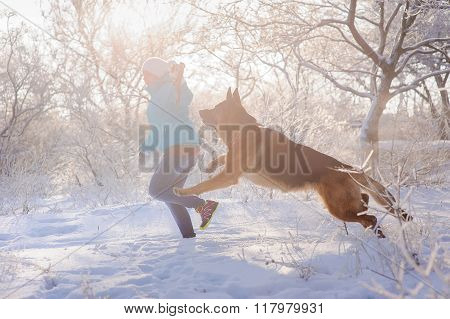 Girl play her German Shepherd dog