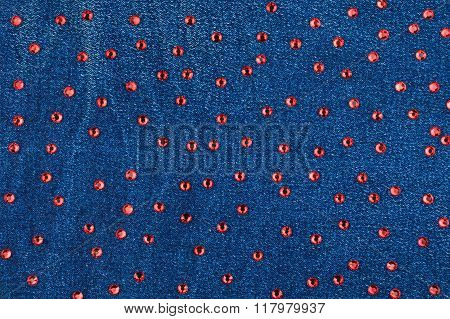 Abstract Background With Red Rhinestones On Denim