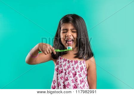 indian girl and tooth brush, indian girl and brushing, asian girl with tooth brush and paste, indian