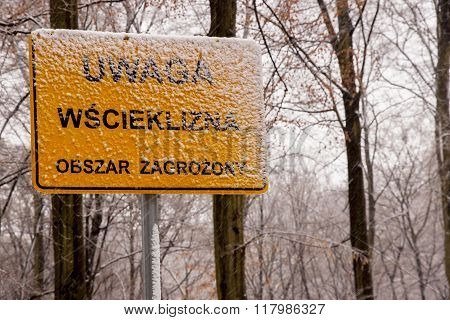 Warning Sign For Rabies Crossing On Polish Forest