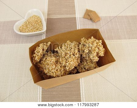 Chocolate nuggets with amaranth in paper bag