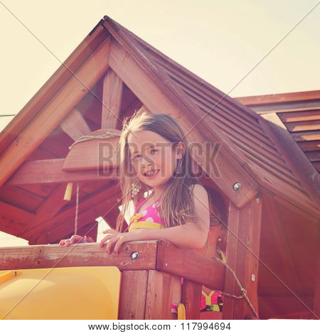 Young girl in tree house with instagram effect