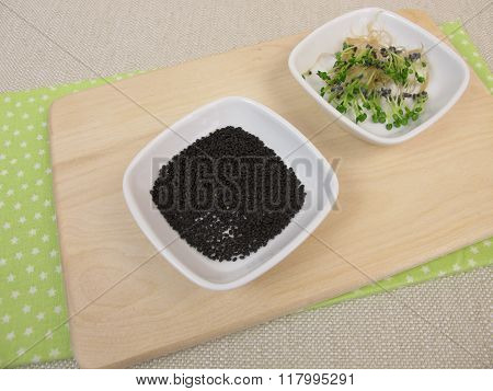 Basil sprouts and germinating seeds