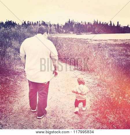 Little Baby girl walking path with father - instagram effect
