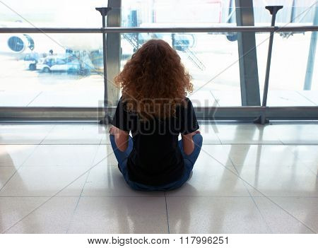 Woman waiting for her flight on airport