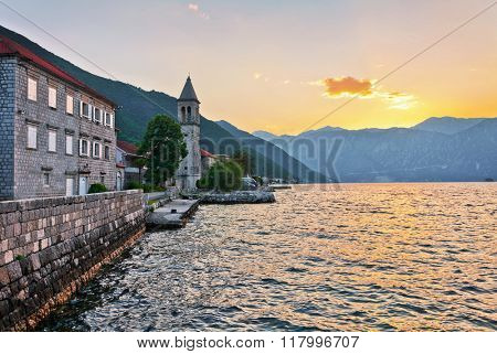 The old church overlooking the sea in sunset time. Montenegro