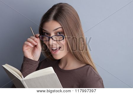 Cute smart girl is studying very well