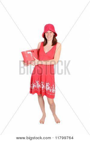 Cute Teen In A Periwinkle  Dress Holding Bucket