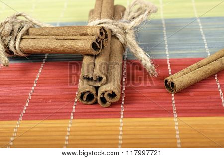 Cinnamon Sticks On Colorful Background.
