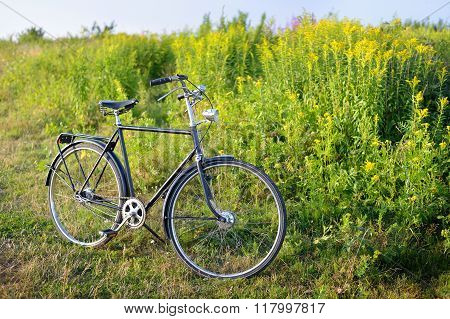 Old Dutch Retro Bicycle On The Field In A Rural Area. Shallow Depth Of Field