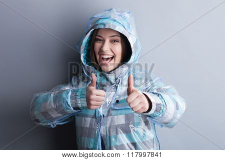 Cheerful young girl prefers rainy weather