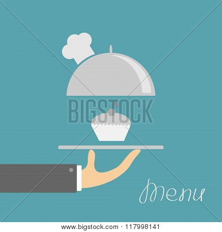 Hand Holding Silver Platter Cloche With Chefs Hat. Menu Card. Blue Background. Flat Design.