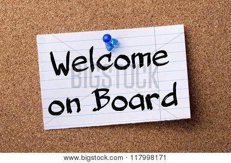 Welcome On Board - Teared Note Paper  Pinned On Bulletin Board