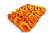 image of dry fruit  - Dried peaches in trays isolated on white background - JPG