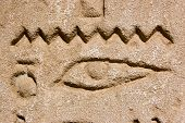 pic of horus  - An Ancient Egyptian hieroglyphic carving of an eye surmounted by the zig zag line of water - JPG