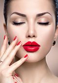 Beautiful Fashion woman model face portrait with red lipstick and red nails. Glamour girl with brigh poster