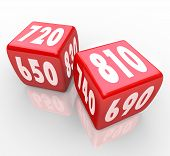 stock photo of crap  - Two red dice with credit scores on their faces - JPG