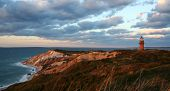 stock photo of martha  - sunset over lighthouse and red cliffs at martha - JPG
