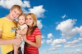 Family With Boy On White, Fluffy Clouds In Blue Sky Collage poster