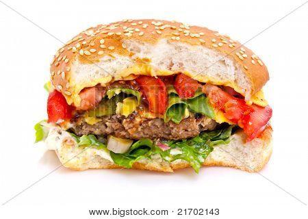 Closeup of a half-eaten fast food hamburger.  White background