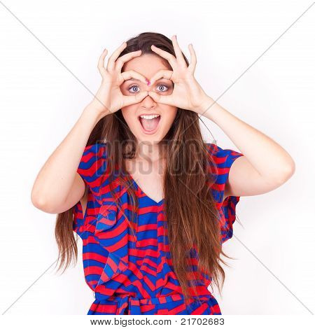 Young Beautiful Women Happy Making Googles Gesture On Face